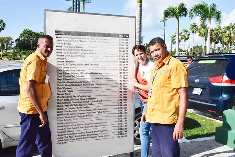 woman with two taxi driver and price list of local transportation via taxi in Punta Cana