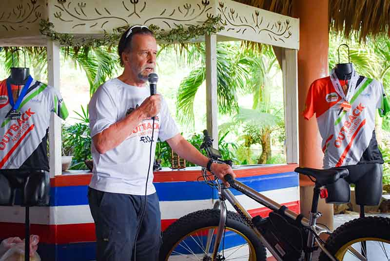 man presenting new mountain bike on Outback Adventure ranch in Anamuya - Dominican Republic