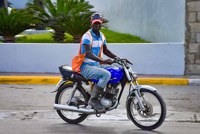 man driving a moto taxi in Punta Cana