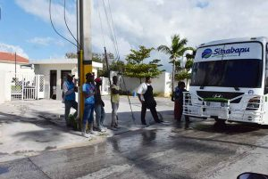 people waiting for local bus in Punta Cana - Dominican Republic