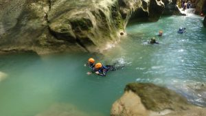 people swimming in river as part of canyoning tours in Cabarete - Dominican Republic
