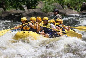 people having fun on white water rafting tours with guide in Jarabacoa - Dominican Republic