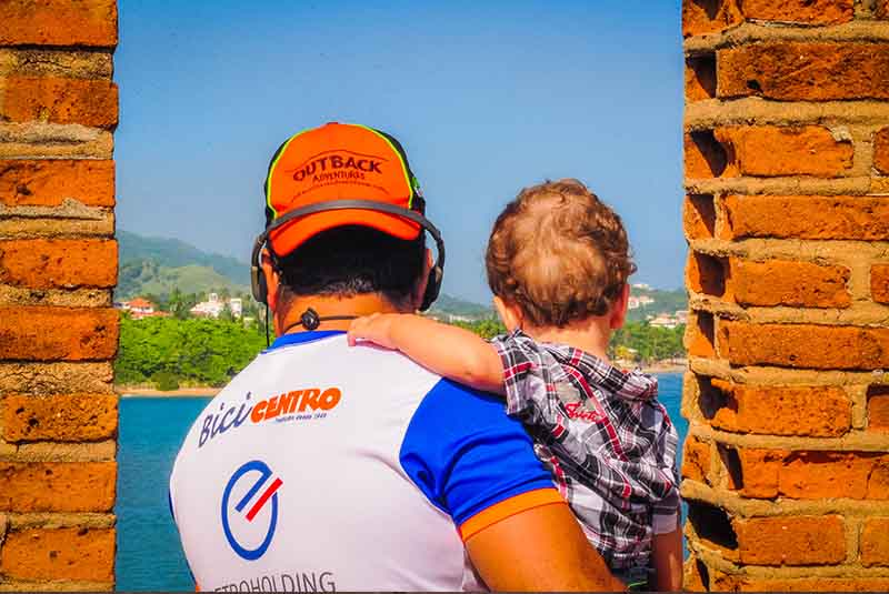 man with child enjoying the view from fort San Felipe in Puerto Plata - Dominican Republic