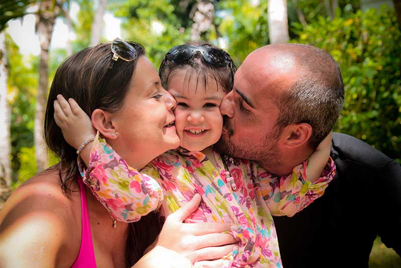 girl hugging her parents - Dominican Republic
