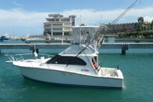 fishing vessel leaving Puerto Plata port for deep sea fishing tours- Dominican Republic