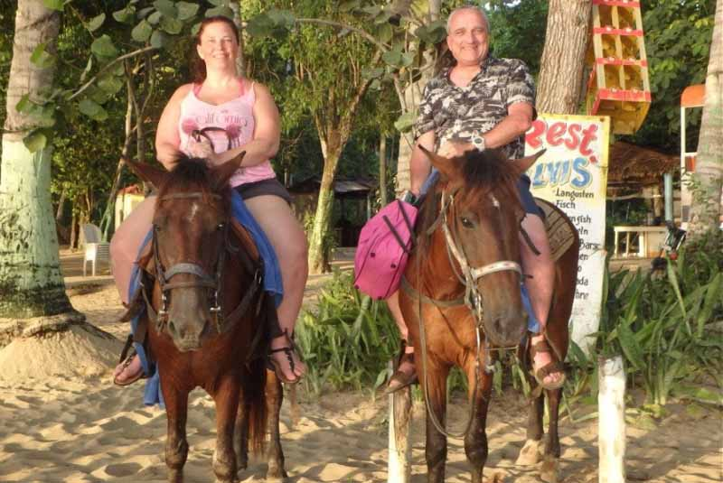 couple sitting on horses in Puerto Plata - Dominican Republic