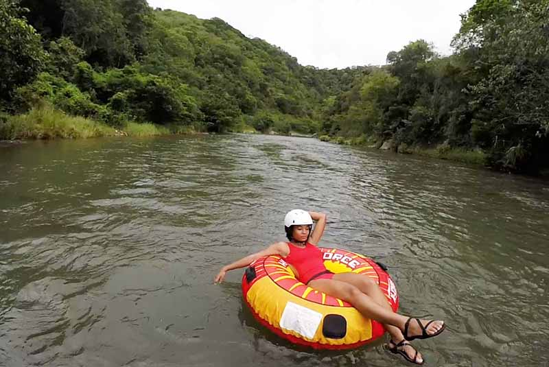 woman enjoying river tubing excursion in Puerto Plata - Dominican Republic