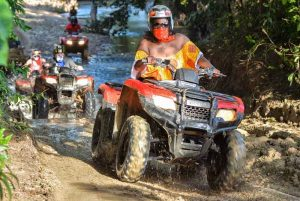 woman driving through river on one of the ATV tours in Puerto Plata -