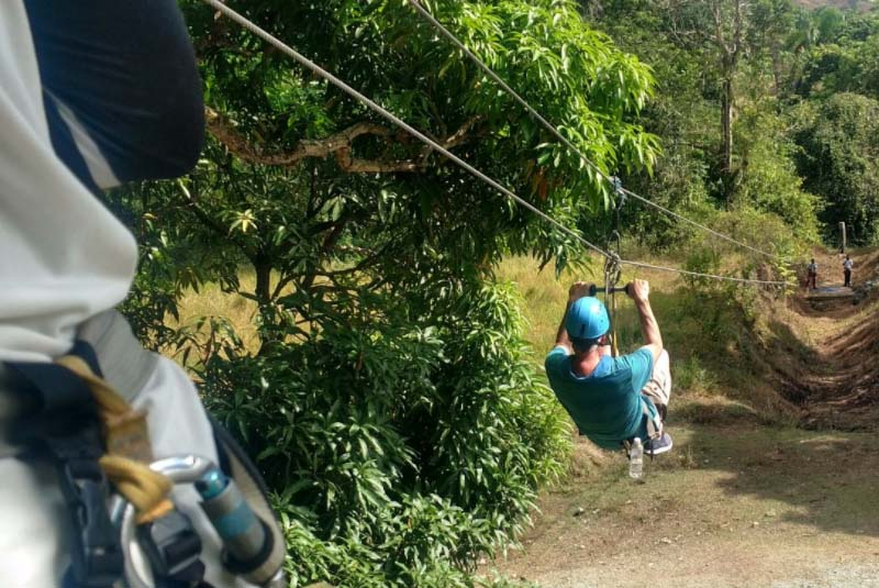 man zip lining in Puerto Plata - Dominican Republic