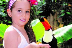 smiling girl posing with tropical bird in Puerto Plata - Dominican Republic