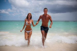 couple running at the beach in Puerto Plata - Dominican Republic