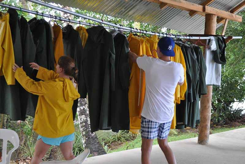 guests getting rain coats for whale watching tour in Samana - Dominican Republic