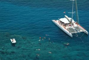 Catamaran with guests snorkeling in Sosua - Dominican Republic