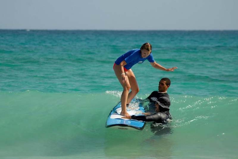 girl getting surf lessons in Macao - Punta Cana