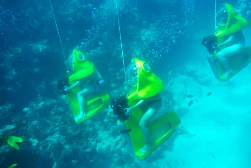 people riding a scuba doo under water in Punta Cana - Dominican Republic