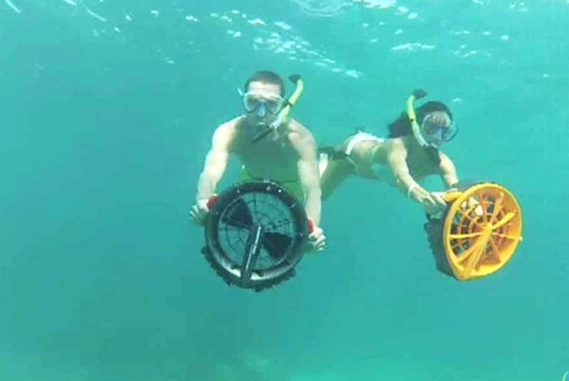 two person snoekling with under water jets in Punta Cana - Dominican republic