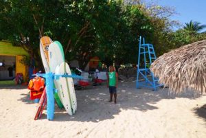 Guide waiting for students at surf school at Long Beach - Puerto Plata