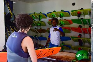 boy getting surf equipment from staff at Rad Park in Punta Cana