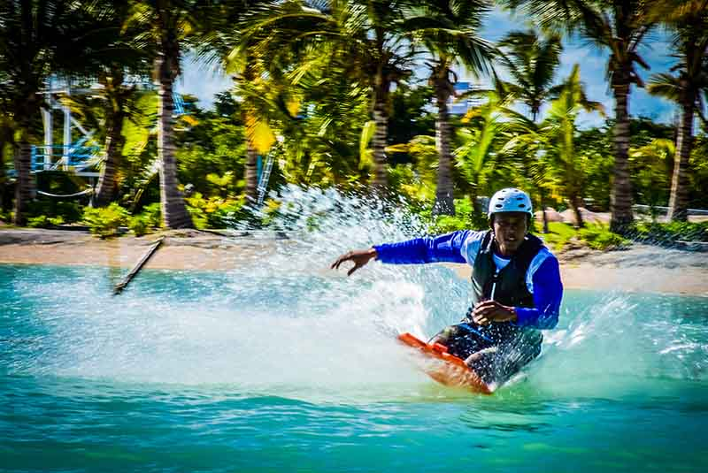 man knee boarding at water park in Punta Cana - Dominican Republic