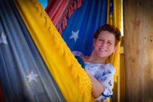 woman smiling and relaxing in hammock in Punta Cana - Dominican Republic