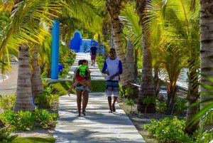 family with children walking in Rad Park Down Town Punta Cana - Dominican Republic