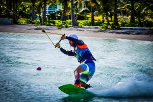 man surfing with wake board on lake in Punta Cana - Dominican Republic
