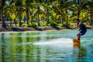 boy practicing wake boarding on lake at Rad Park in Punta Cana - Dominican Republic
