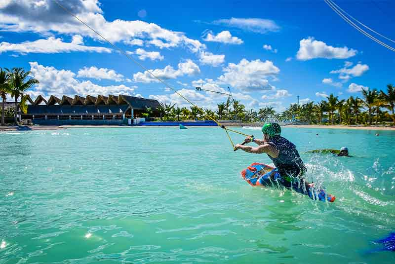 boy knee boarding on lake at water park in Down Town Punta Cana - Dominican Republic