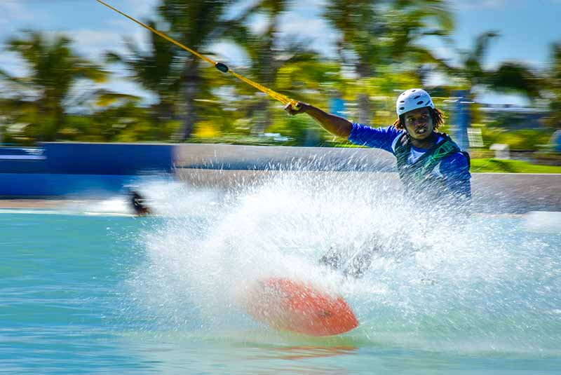 man surfing on wake board at Rad Park in Punta Cana - Dominican Republic