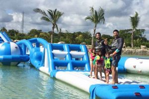 men with children standing on inflatable obstacle course at Rad Park in Punta Cana - Dominican Republic