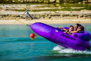 woman with children having fun on inflatable ride at Rad Park in Punta Cana - Dominican Republic