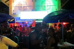poeple at beach bar at night in Puerto Plata - Dominican Republic