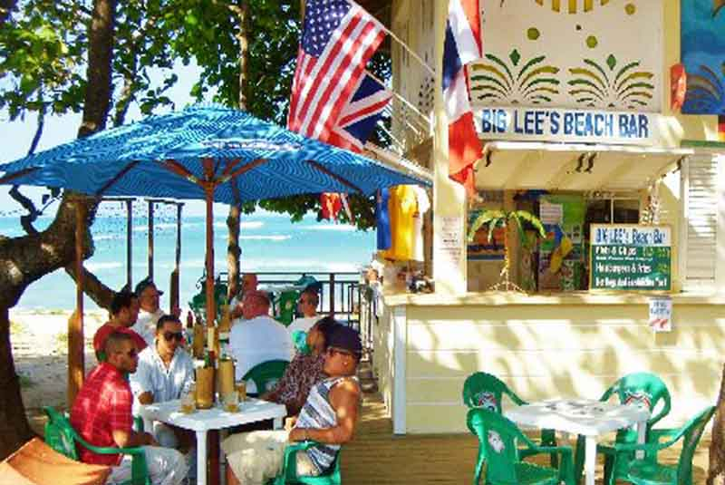 Beach bar with guests on Puerto Plata beach Boulevard - Dominican Republic