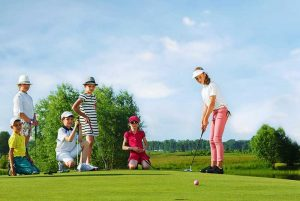 group of children playing golf - Dominican Republic