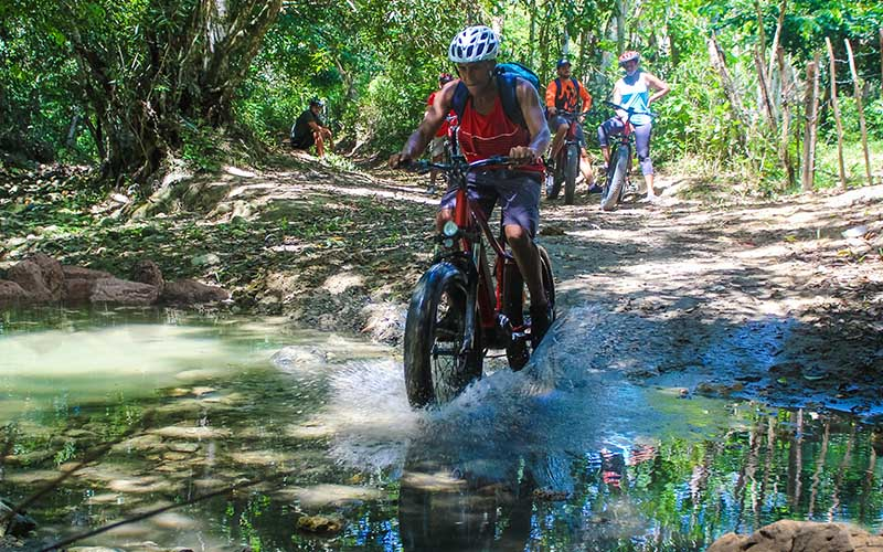 have fun riding electric bike through the countryside, passing streams and rivers of Puerto Plata
