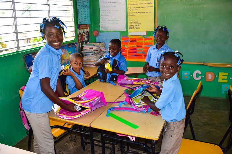 happy school kids in local school in la Ceiba - Punta Cana